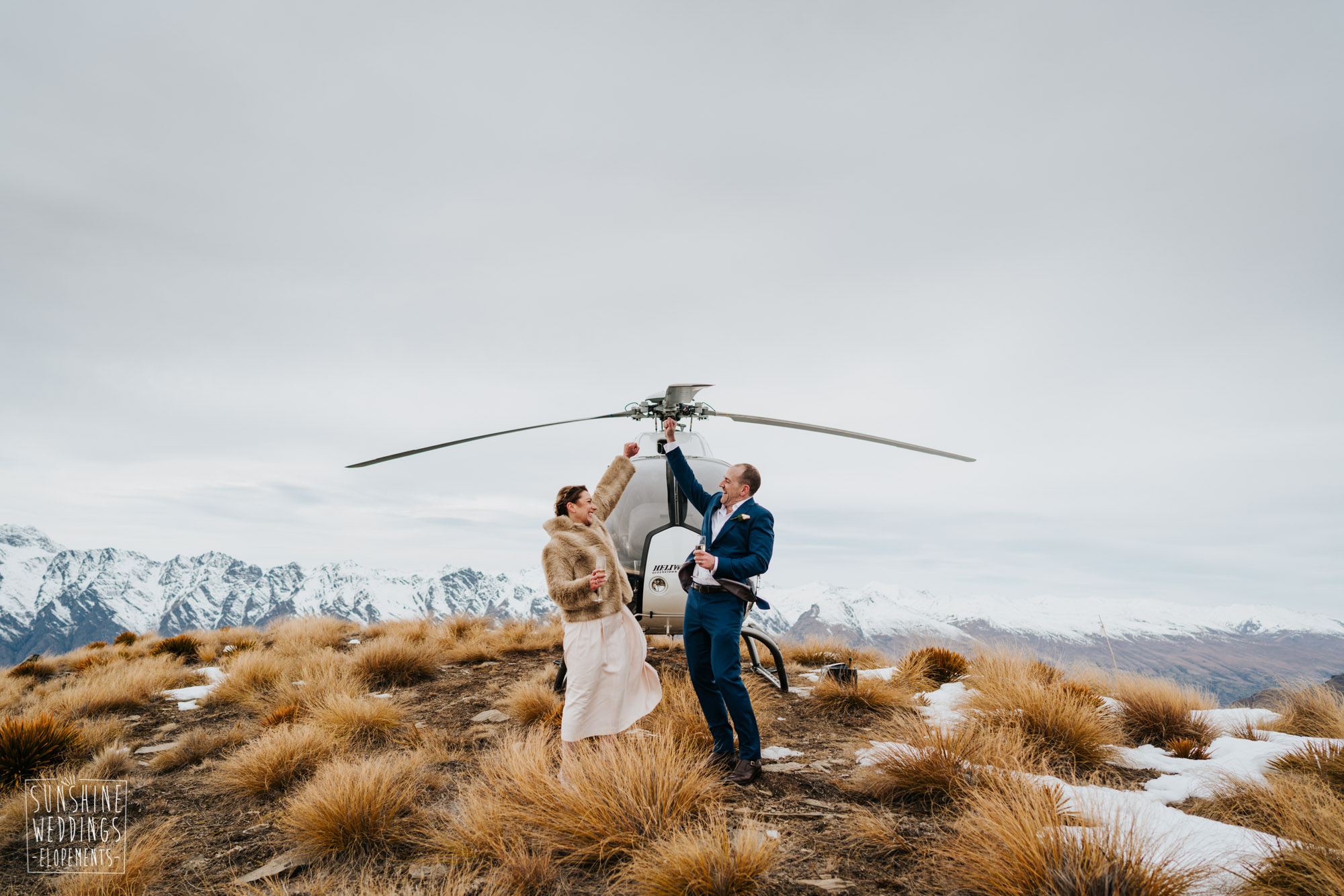 Wedding in front of helicopter on Cecil Peak Queenstown